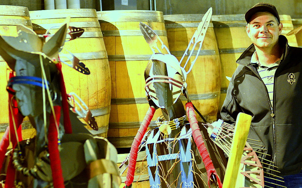Justin Hall, a member of the Osoyoos Indian Band, is the assistant winemaker at Nk'Mip Cellars in Osoyoos, British Columbia. (Photo by Abra Bennett/Great Northwest Wine)