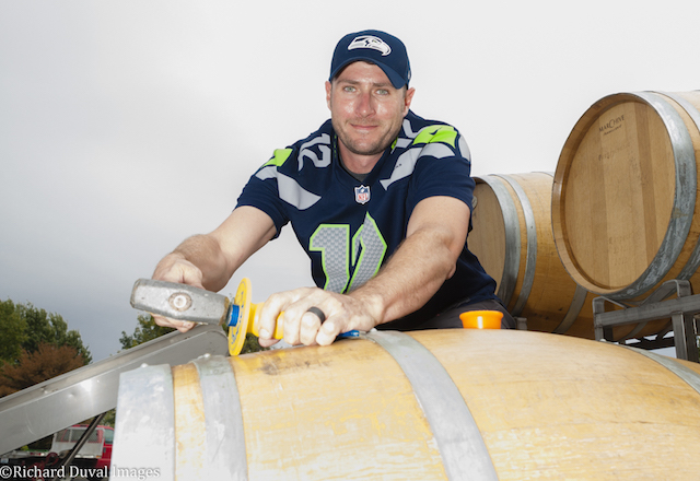 College Cellars winemaker Marcus Rafanelli makes adjustments to a barrel at Walla Walla Community College.